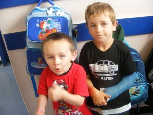 Jayden and Zac make sure their bags are hanging up tidily.